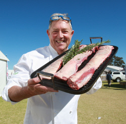 CTY-0003258 © WestPix WA Food Ambassador Don Hancey cooked dry-aged Merino mutton with a difference at the Good Food and Getaways Pavilion at Dowerin. Picture: Bob Garnant