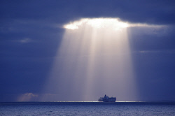 FEA-0007242 © WestPix Clouds open up with two ships in the spotlight. Picture: Shaun Fearn