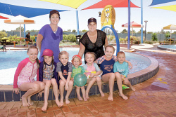 KGM-0029275 © WestPix Hot weather in the City of Kalgoorlie-Boulder. Enjoying the water at the Goldfields Oasis are Tracey Castlehow and Marie Waddell with children Georgia Castlehow 10, Phoebe Castlehow 7, Poppy Waddell 6, Oscar Waddell 1, Molly Waddell 4, Millie Castlehow 10, Hamish Castlehow 4. Picture: Mary Meagher.