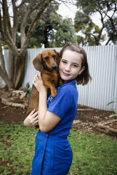 KGM-0029934 © WestPix Emily May, 10, holding Penny the Dachshund. Picture: Tegan Guthrie
