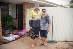 KGM-0029991 © WestPix Rain in Kalgoorlie-Boulder.  Picture: Mary Meagher. Helen Carn and her son Jason Prince.