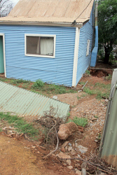 KGM-0029994 © WestPix Rain in Kalgoorlie-Boulder.  Picture: Mary Meagher. Williamstown property that was flooded to reveal a old mine shaft under the house.