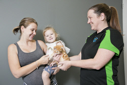 KGM-0032796 © WestPix Young Parents Group at Headspace Kalgoorlie animal therapy session, Steph Armstrong with Aniyah Armstrong, 2, and RSPCA volunteer carer Louise Sutcliffe. (Picture: Louise White) 2nd June 2017