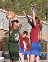 KGM-0033236 © WestPix CAPS Vs JPC basketball carnival. Nyheemah Cox with Charlotte Hanekom defending. Picture: Mary Meagher.