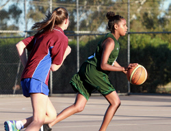 KGM-0033238 © WestPix CAPS Vs JPC basketball carnival. Shanita Field chases Sye Cox. Picture: Mary Meagher.