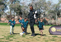 KGM-0034149 © WestPix Football West workshop at East Kalgoorlie Primary School.  Picture: Mary Meagher. Savannah Kickett 5, Stuart Brockman 5, Josiah Graham 5, Elmi Ali Football West Inclusive Development Officer and Robert Walley 5.