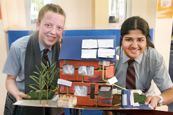 KGM-0034623 © WestPix Amy Astill 15 and Amn Akram 16 of John Paul College with their six star energy designed building.  Picture: Mary Meagher.