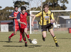 KGM-0035250 © WestPix Goldfields Soccer Association, Twin City Saints V Boulder City.  Picture: Mary Meagher. Twin Jake Duncan and Boulder Nic Duncan.