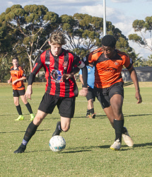 KGM-0035435 © WestPix Goldfields Soccer Association, South Red Strikers and North Scorchers. U 15s.  Picture: Mary Meagher. Strikers Kyle Lamprecht and Scorchers Agbonluai Ouigele.