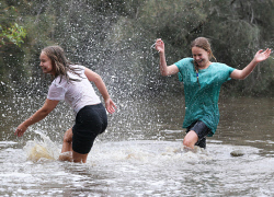 SUN-1401057 © WestPix The Avon River is experiencing flooding with a possible risk to homes. Pictured are Lillian (12) and Elizabeth (10) in Toodyay. Picture - Justin Benson-Cooper The Sunday Times