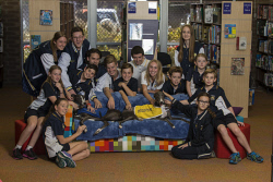 SUN-1401224 © WestPix Woodvale Secondary College's dog program. They have 2 greyhounds, Boots (blue jacket) and Rush (yellow jacket), who â??job-shareâ?� the role of teaching students about empathy and caring for animals. Pictured with them is a group of students. 31 March 2017.  Picture: Ross Swanborough - The Sunday Times.