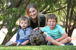 SUN-1401316 © WestPix This family-run wildlife sanctuary takes Aussie critters to meet people at care homes and schools. They're about to introduce two orphaned wombats into their cast of animals. West Oz Wildlife co-owner Beth Mullany with sons Harper (2) and Cooper (6) and Annie the wombat. Picture: Daniel Wilkins