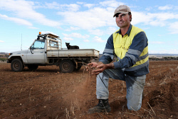 SUN-1402195 © WestPix The Sunday Times is looking at farming conditions in the Wheatbelt with some  parts being very dry, while other parts are wet. Pictured is York farmer Duncan Young with dog Diesel on his property near the town. Picture - Justin Benson-Cooper. The Sunday Times