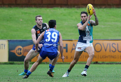 SUN-1402659 © WestPix WAFL Round 17 - East Perth Royals vs Peel Thunder at Leederville Oval, Leederville. Pictured - Peel's Harley Bennell gathers the ball in front of East Perth's Tom Cole. Picture: Daniel Wilkins