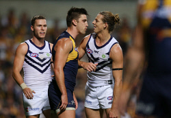 SUN-1402660 © WestPix AFL Round 6 - West Coast Eagles v Fremantle Dockers at Subiaco Oval, Perth. Pictured - Eagle Elliot Yeo has some words for Fremantle's Nathan Fyfe during the third term. Picture: Daniel Wilkins