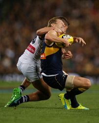 SUN-1402692 © WestPix AFL Round 6 - West Coast Eagles v Fremantle Dockers at Subiaco Oval, Perth. Pictured - Eagle Sam Mitchell is tackled high by Fremantle's Darcy Tucker. Picture: Daniel Wilkins