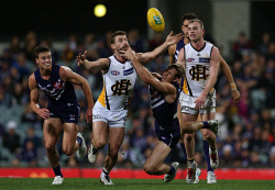 SUN-1402702 © WestPix Sport - AFL - Round 18 Fremantle Dockers v Hawthorn Hawks at Subiaco Oval in Perth.  Pictured - Docker Nat Fyfe takes down Hawk Brendan Whitecross. Picture - Justin Benson-Cooper. The Sunday Times