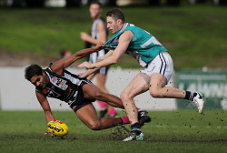 SUN-1402808 © WestPix WAFL Round 19 - Swan Districts vs Peel Thunder, Steel Blue Oval, Bassendean. Pictured - Swan's Warrick Wilson tries to gather the ball, under pressure from Peel's Zac Dawson Picture: Daniel Wilkins