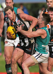 SUN-1402811 © WestPix WAFL Round 19 - Swan Districts vs Peel Thunder, Steel Blue Oval, Bassendean. Pictured - Peel's Rory O'Brien tries to tackle Swan's Matt Riggio. Picture: Daniel Wilkins