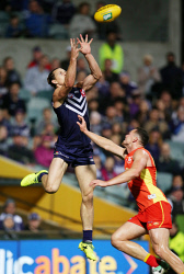SUN-1402864 © WestPix AFL Round 20 - Fremantle Dockers vs Gold Coast Suns at Subiaco Oval, Perth. Pictured -  Fremantle's Nathan Fyfe flies for a mark over Gold Coast's Steven May. Picture: Daniel Wilkins