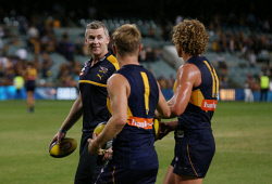 SUN-1402900 © WestPix AFL Round 2 - West Coast Eagles vs St Kilda Saints, at Subiaco Oval, Perth. Pictured - West Coast coach Adam Simpson is all smiles as he chats with Sam Mitchell and Matt Priddis after the game. Picture: Daniel Wilkins