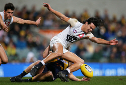 SUN-1402973 © WestPix AFL Round 21 - West Coast Eagles vs Carlton Blues at Subiaco Oval, Perth. Pictured - Carlton's Jack Silvagni is pulled off the ball by Eagle Jackson Nelson. Picture: Daniel Wilkins
