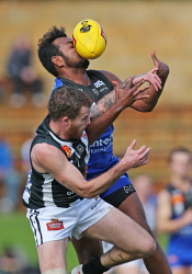 SUN-1402975 © WestPix WAFL Round 21 - East Perth Royals vs Swan Districts, Leederville Oval, Leederville. Pictured - East Perth's Willie Rioli pulls down a mark, despite the presure from Swan's Kirk Ugle. Picture: Daniel Wilkins
