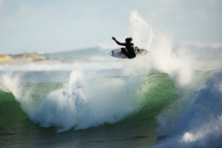 TWA-0009623 © WestPix The world's best surfers surf North Point in Gracetown after yesterday's round in the Drug Aware Margaret River Pro. Ricardo Christie perfroms an aerial. Photo by Michael Wilson, The West Australian 17th April 2015.