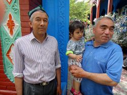 TWA-0052532 © WestPix AGENDA / Business story -  Xinjiang Region in China - Erken Mamade holds his granddaughter Nafisa in the courtyard of his home in Kazanqi in Yining. Picture Mark Mallabone The West Australian