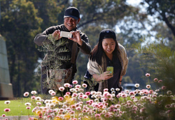 TWA-0053621 © WestPix Friends (L) Bernie Barga and Riestel Mabalhin enjoying the spring wildflowers in bloom at Kings Park today. Picture: Megan Powell The West Australian.