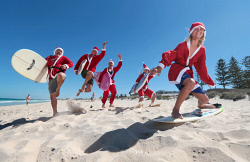 TWA-0060459 © WestPix Levi Berry, 12, front, and fellow surfing Santas Adam Poat, Andy Dean, Clare Doherty and Kate Doherty will be among those catchingwaves in Scarborough on Christmas Eve as part of the annual charity event. 16 DECEMBER 2016 Picture: Danella Bevis The West Australian