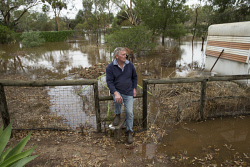 TWA-0063166 © WestPix Mal Fegan watches the water slowly creep into his back yard as the Mortlock River breaks it's banks in Northam. Picture: Steve Ferrier The West Australian.