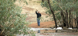 TWA-0063167 © WestPix Greg Beange stands where his driveway ends and the Spencers Brook has cut his property off from civilization. Picture: Steve Ferrier The West Australian.