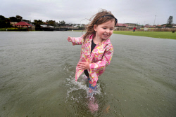 TWA-0063169 © WestPix Imogen Cunnah, 3, plays in the big water mass which formed over the cricket pitch and surrounding area at Abbett Park, Scarborough after record rains overnight. 10 FEBRUARY 2017 Picture: Danella Bevis The West Australian