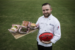 TWA-0065439 © WestPix Sports Service WA Executive Chef Chris Pollard with some of the new items available during this year's AFL season. Picture: Michael Wilson The West Australian