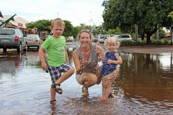 TWA-0065991 © WestPix Harry Astles, 3, Kate Kimber, 40, and Skye Astles, 2, enjoying the puddles in Chinatown's Carnarvon Street after this morning's deluge. Picture: Jakeb Waddell