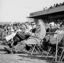 TWA-0069685 © WestPix THE SPECTATORS WATCHING THE CLAREMONT VERSUS WEST PERTH AT LEEDERVILLE OVAL. Pictured - Graham 'Polly' Farmer on the sidelines. 3/8/1968