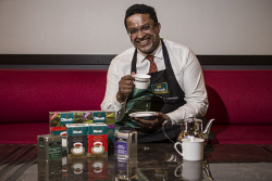 TWA-0070976 © WestPix Dilmah Tea Director Dilhan C. Fernando with some products at Crown Perth today. Photo: Michael Wilson The West Australian