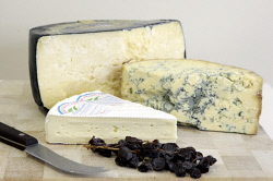 TWA-0071045 © WestPix Deli Divine cheese shop. King Island 2 year old cheddar (big), Will Studd select stilton (medium) and Brie de Comtois. Picture Robert Duncan The West Australian 20 January 2010
