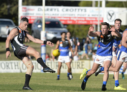 TWA-0071112 © WestPix WAFL. East Perth v Swan Districts at Steel Blue Oval. Swan's Ryan Crowley kicks ahead of East Perth's Kurt Mutimer. Picture: Stewart Allen