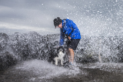 TWA-0073249 © WestPix Wild weather. Sean Tozer and dog Beau brave the elements at Cottesloe Beach. Picture: Simon Santi The West Australian