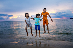 WAN-0001194 © WestPix Tsunami orphans 10 years on: Panlan, 9 (her mother was pregnant when the tsunami hit), Nook, 8 (her mother survived but later died of injuries sustained during the tsunami), and Gan, 10 at Baan Nam Khem beach, north of Khao Lak, in Thailand. PIC BY: STEVE PENNELLS