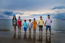 WAN-0001196 © WestPix Tsunami orphans 10 years on: (left to right) Fang, 15, her brother, Got, 13, Nook, 8, Panlan, 9 (her mother was pregnant when the tsunami hit), Gan, 10, Tess, 22, and Game 22 at Baan Nam Khem beach, north of Khao Lak, in Thailand. PIC BY: STEVE PENNELLS