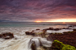 FEA-0007301 © WestPix Beautiful Perth sunset with water spashing over the seaweed. Picture: Shaun Fearn