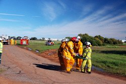 GGU-0006163 © WestPix Fire rescue volunteers carry victims from the wreckage to the triage area. Plane crash exercise at the Geraldton Airport. Picture: Jon Solmundson The Geraldton Guardian