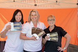 KGM-0029155 © WestPix Boulder Market Day, Business Socials. Jacqui Tinkler, Melissa Hall and Kylie Lampros of the Goldfields Children's Charity with raffle tickets for sale. Picture: Mary Meagher.