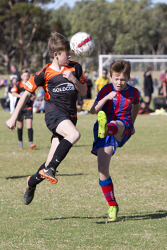 KGM-0035246 © WestPix Junior Soccer, Under-13 semi-finals, Twin City Boomers vs Norths Heat, Norths' Jacob Strachan and Twin City's Jack Pettingill. (Picture: Louise White) 2nd September 2017