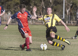 KGM-0035249 © WestPix Goldfields Soccer Association, Twin City Saints V Boulder City.  Picture: Mary Meagher. Twin Jason Gorrie and Boulder Paul Johnson.