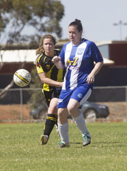 KGM-0035318 © WestPix Goldfields Soccer Association, Boulder City Soccer Club V Kalgoorlie College.  Ladies grand final.  Picture: Mary Meagher. Boulder Sophie Luke and  Kalgoorlie Paula Bennett.
