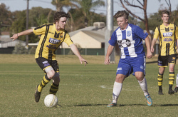 KGM-0035322 © WestPix Goldfields Soccer Association, Boulder City Soccer Club V Kalgoorlie College. Mens grand final.  Picture: Mary Meagher. Boulder Patrick Colton and Kalgoorlie Brock Reilly.